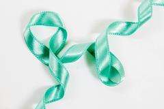 irregular shaped shiny green  ribbon - stock photo