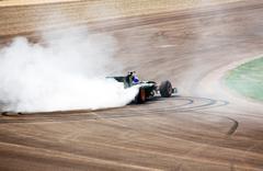 Formula one car wheelspin Stock Photos
