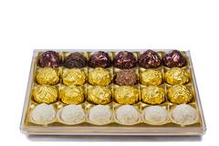 Chocolate sweets in the box on the white background. Stock Photos
