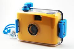 Stock Photo of yellow camera in waterproof box