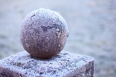 granite ball on a pedestal - stock photo