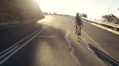 Healthy man cycling road bicycle outdoors fitness steadicam shot Stock Footage