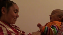 Cheerful mother talks to three months old baby Stock Footage