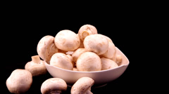 Champignons in a white bowl Stock Footage