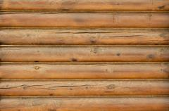 wall from logs. - stock photo