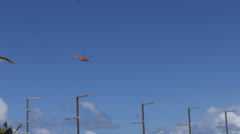 Us coast guard helicopter flying flight over waterfront coast line Stock Footage