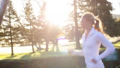 Young woman running in the morning Stock Footage