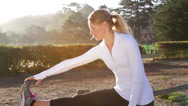 Stock Video Footage of Young woman stretches before a morning run
