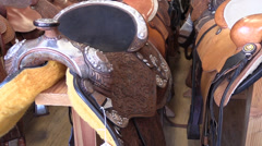 saddles for horses and mules - stock footage