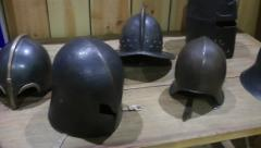 Historical helmets on display in museum HD Stock Footage
