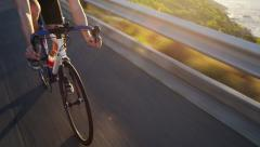 Close up man cycling road bicycle outdoors fitness steadicam shot Stock Footage