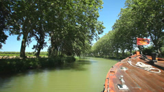 Travelling on a wooden boat on June 22, 2013 on the Canal du Midi, France. Stock Footage