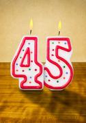 Burning birthday candles number 45 Stock Photos