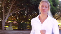 Personal Fitness - A Young Beautiful Woman Runs along Country Back Roads Stock Footage