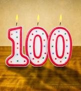 burning birthday candles number 100 - stock photo