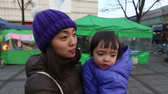 Baby and Mother Walking in the City GlideCam 1 Stock Footage