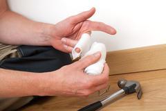Stock Photo of bandaging hurt finger
