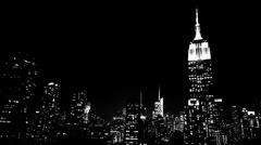 Gotham Dark and Dramatic - Empire State Building on a Cold NYC Night Stock Photos