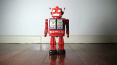 retro red robot marches forward on wooden floor - stock footage