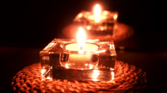 Candle in glass container - stock footage