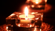 Stock Video Footage of Candle flame and its reflection glowing