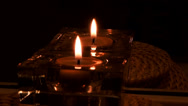 Stock Video Footage of Candle in glass container with reflection