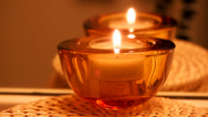 Stock Video Footage of Candle in red glass container