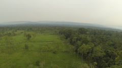 Flying over cattle pastures cut out of primary rainforest - stock footage