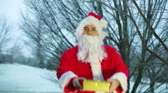handing present gold santa - stock footage