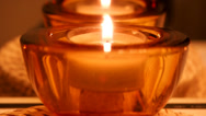 Stock Video Footage of Close-up of candle in red glass container