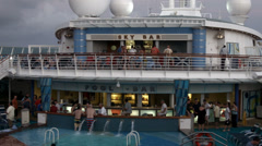 Cruise ship otside bar swimming pool evening HD BM 1745 Stock Footage