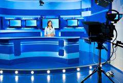Television newscaster at blue tv studio Stock Photos