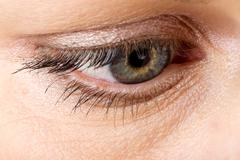 middle age woman eye macro - stock photo