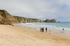Holidaymakers on Porthcurno beach Cornwall England UK by the Minack Theatre - stock photo
