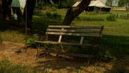 Stock Video Footage of Old Bench and WindChimes 2