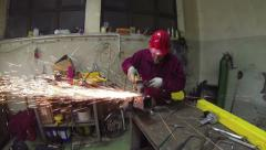Worker in Action With Angel Grinder Stock Footage