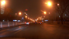 Driving along famous East Chang'an Avenue at night, Beijing, China Stock Footage