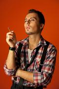 celebrity resemblance. johnny deep lookalike. stylish young man with cigarett - stock photo