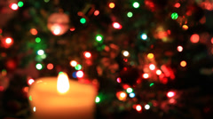 Flame of candle on christmas lights Stock Footage