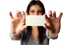 Young businesswoman holding blank business card isolated on white background Stock Photos