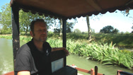 Stock Video Footage of Captain driving tourists on barge on June 22, 2013 on the Canal du Midi, France.