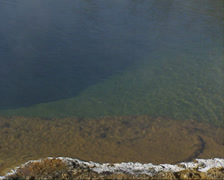Hot water pool in Black Sand Basin, Yellowstone National Park - close up Stock Footage