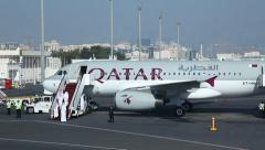 Sheikhs embark airplane of Qatar Airways  Stock Footage