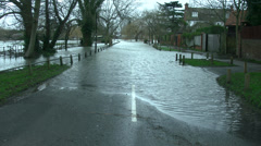 River flooding nearby streets, River Thames Stock Footage