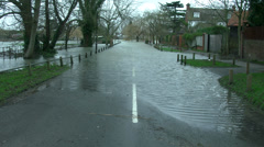 Flooded road, flooding, natural disaster, force of nature - stock footage