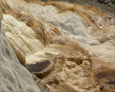 Water flow over travertine terraces of Mammoth Hot Springs  - full screen - stock footage