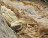 Stock Video Footage of Water flow over travertine terraces of Mammoth Hot Springs  - full screen