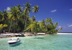 Boat moored off the coast of kuda bandos, north male atoll, maldives Stock Photos