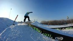 Snowboarder jumps trick Stock Footage
