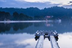 kandy lake and the temple of the sacred tooth relic - stock photo